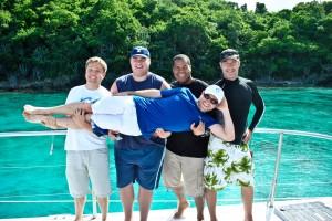 The early DigiCert crew: (from left) Paul Tiemann, Jeff Snider, Flavio Martins, Ken Bretschneider, holding Chris Skarda.